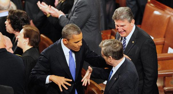 130212_obama_manchin_handshake_shinkle_605_605